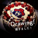 自分の描いた似顔絵が使われたケーキの写真